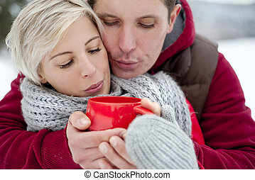 Couple in winter - Woman and man are relaxing in winter...
