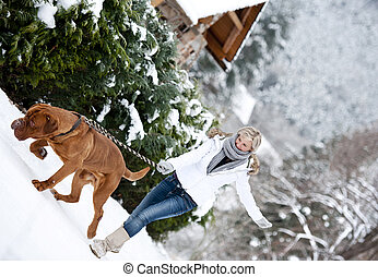 Woman with dog - Blonde girl is having fun with her big...
