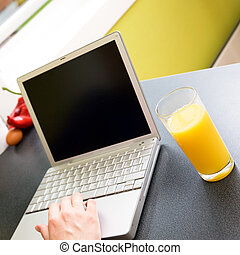 Healthy On Computer - A person used a laptop computer while...