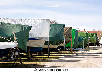 Winter Boat Storage - A row of boats in storage for the...