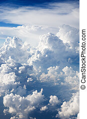 Cumulus Clouds - A dramatic cloudscape background with...