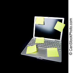 Sticky Note on Laptop - A sticky note on a laptop computer -...