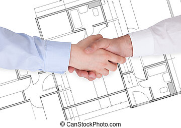 Two Businesspeople Shaking Hands - Close Up Of Two...