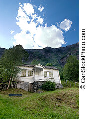Mountin House - Mountains looming over a house in rural...