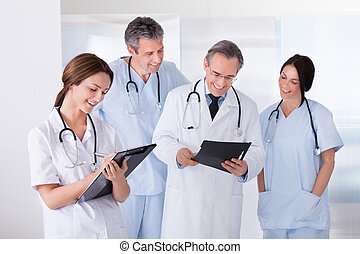 Portrait Of Happy Doctors Working Together - Happy Female...