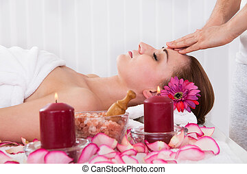 Woman getting spa treatment - Woman getting treatment in the...