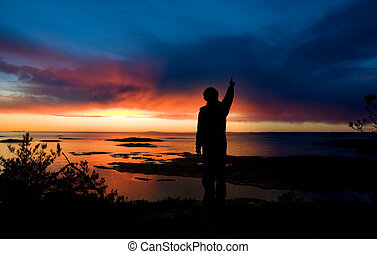 Ocean Discovery - A person standing by the ocean pointing...