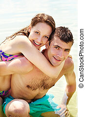 Romance - Portrait of happy couple on summer vacation...