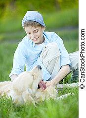 Cuddling dog - Portrait of cute lad cuddling his fluffy...