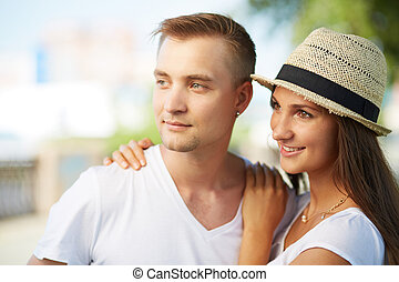 Togetherness - Happy girl and her boyfriend looking forward