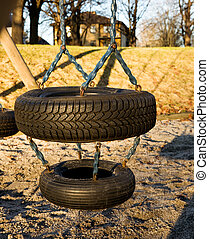 Tire Swing - A childs swing on a playground