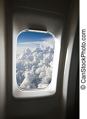 Plane Window - A view of clouds from an airplane window