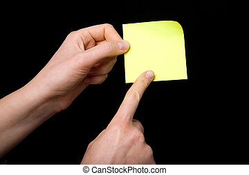 Sticky Note - A blank sticky note stuck to a hand - remember...