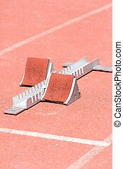 Support of foot athletics - Closeup starting blocks on red...