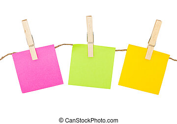 Colorful sticky notes with clothespins isolated on white...