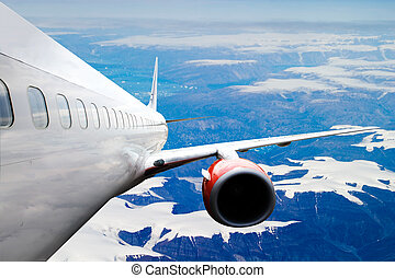 Airplane over Iceland - An airplane accending over a...