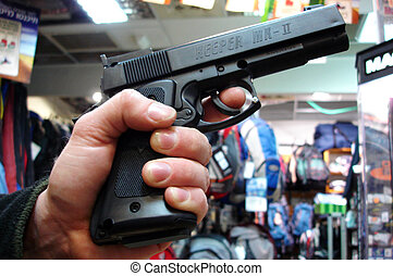 Man holds a gun - TEL AVIV - MAR 28: Man holds a gun on Mar...