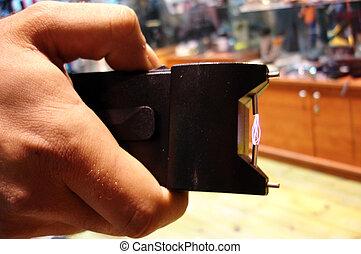 Man holds a stun gun - TEL AVIV - MAR 28:Man holds a stun...