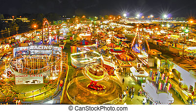 Ride at county or state fair in evening
