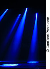 stage lighting effect in the darkness, closeup of photo