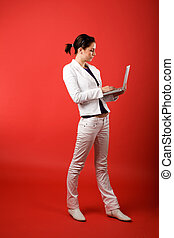 Valentines Email - A young woman typing on a laptop computer...