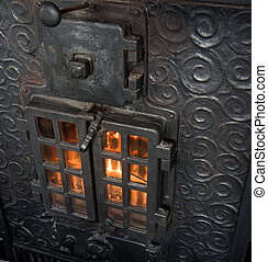 Cast Iron Fireplace - An old cast iron oven with flames...