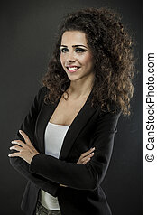 Portrait of a young attractive woman with beautiful curly...