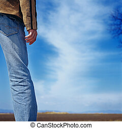 man decision cowboy sky wait - young man standing on a field...