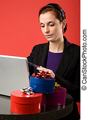 Christmas Shopping Online - A young female shopping for...