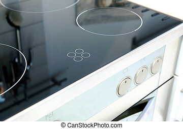 Ceramic Stove Top - A ceramic stove top with an oven in...