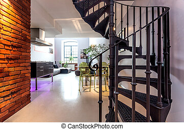 Spiral stairs and living room in modern loft