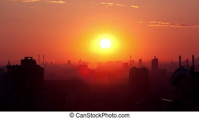 Sunrise over the city. Time lapse. High angle. Aerial view....