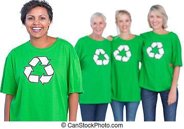 Happy women wearing green recycling tshirts on white...
