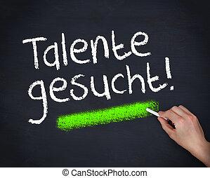 Man writing talente gesucht on chalkboard