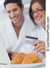 Cheerful couple purchasing online