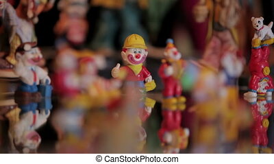 Clown figurines and clock. Panning macro shot.
