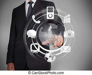 Businessman selecting a hologram on grey background