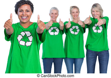 Happy women wearing green recycling tshirts giving thumbs up...