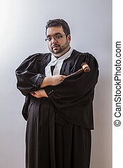 Lawyer and hammer - Man in canadian lawyer toga holding a...