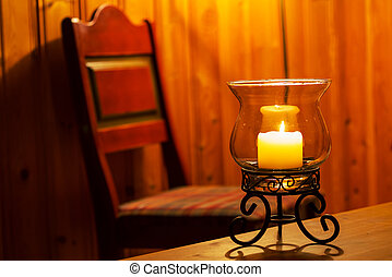 Candle in interior - candle in a wooden room