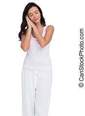 Woman pretending to sleep on a white background