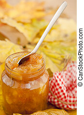 Apple jam - Full jar of apple jam on the leaves