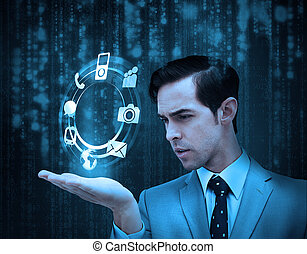 Businessman holding a hologram with smartphone applications...