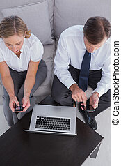 Overhead of business people using their mobile phones and...