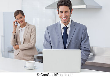 Businessman using a laptop in the morning