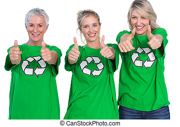 Two women wearing green recycling tshirts on white...