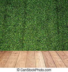 Wood floor with green grass