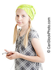 Young girl listening music with here mp3 player