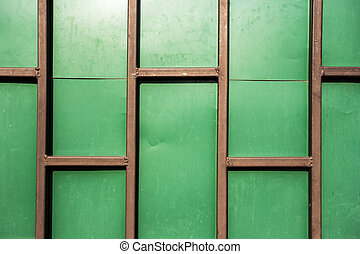 Green wall with rust metal
