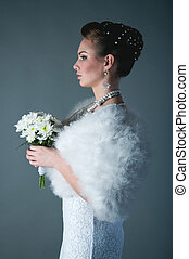 Bride - Studio profile portrait of young pretty fashion...